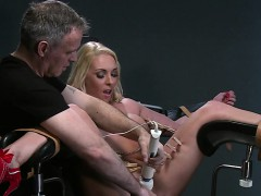 Blonde sub zippered in gyno chair