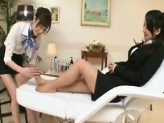 Two Asian cuties engage in passionate lesbian sex on the ma