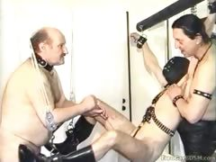 Helpless masked slave gets his cock and balls tortured