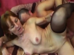 A nasty granny in stockings uses sex toy on her pussy