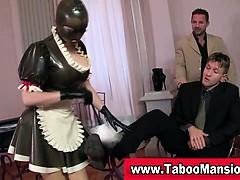 Latex bondage slut licking shoes