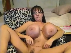 Amateur mature with big silicone Tits
