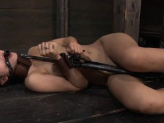 Tied up honey receives her pussy lips opened up for torture