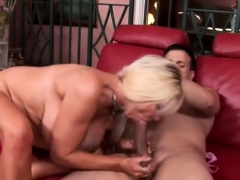 Blonde big boobed mature fucks on sofa
