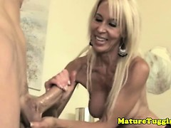 Blonde cougar mame jerking his hard cock
